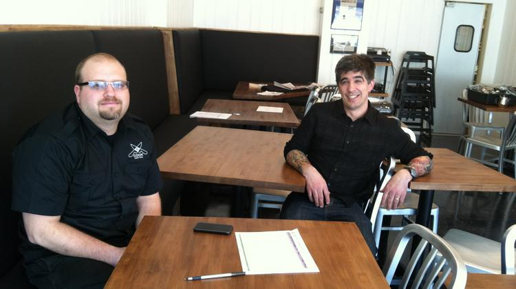 Longtime friends Charles Cook (left) and Eddie Wu will open their Cook St. Paul restaurant Thursday.