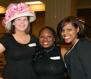 Volunteering at The Fillies Derby Ball were: Kelsey Cooper, left, with Sigma Kappa sorority at Indiana University Southeast; Shay Johnson, of Zeta Phi Beta at IUS; and Michaela Dale, also with Zeta Phi Beta. Cooper modeled a hat that was in the silent auction.