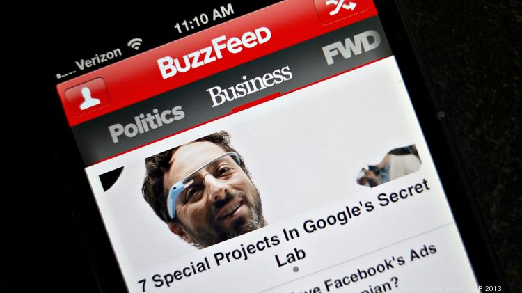Story links are displayed on a business page of the BuzzFeed app on an Apple, Inc. iPhone 5.