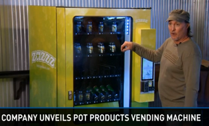 Stephen Shearing, the chief operating officer of American Green's parent company Tranzbyte, unveils a ZaZZZ vending machine, which will dispense pot and related products in Colorado.