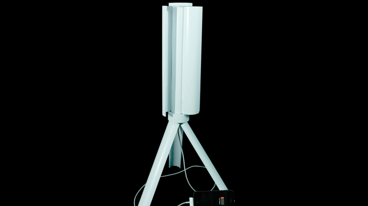 The Skajaquoda Trinity's portable wind-power generator's turbine blades and tripod legs fold into the foot-long device prototype, which weighs 2.5 pounds. The company also plans to make a larger version.