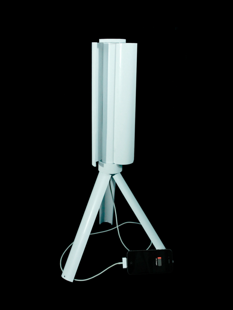 The Skajaquoda Trinity's portable wind-power generator's turbine blades and tripod legs fold into the foot-long device prototype, which weighs about four pounds.
