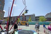 One bungee jumper dangled before falling safely onto a trampoline below.