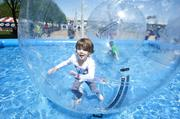 Aubrey Mattingly, 6, had a ball in the Splash Water Ball game for kids at the Chow Wagon.