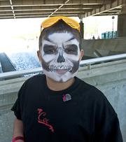 Tatum Wallace, 8, showed off his freshly painted face. Face painters were on hand on Thunder Saturday at the Chow Wagon.