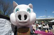 Bucko The Pink Pig, a barbecue vendor at the Chow Wagon, has a unique pig-shaped booth.