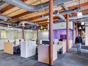 Redesigned lab and office space at several local biotech firms incorporates meeting space and encourages collaboration, said Perkins+Will architect Bill Harris. Courtesy Greg Premru