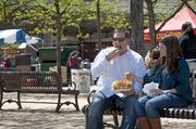 Mark and Jennifer Henry enjoyed a huge plate of homemade potato chips on the waterfront.  The couple recently moved here from Arizona. The Henrys said they were looking forward to their first Thunder Over Louisville experience.