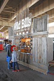 A family waited at Wild Bill's Olde Fashioned Soda Pop Co., one of the more than 100 vendors at the Kentucky Derby Festival's Chow Wagon, which served Thunder Over Louisville patrons.