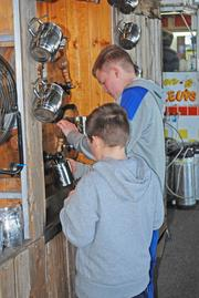 Two young patron filled their mugs at the Wild Bill's Olde Fashioned Soda Pop Co. booth.