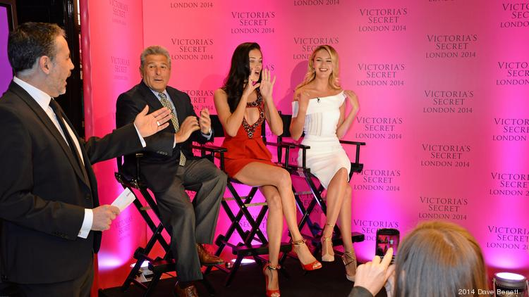 Victoria's Secret Chief Marketing Officer Ed Razek, left, is joined by models Adriana Lima, center, and Candice Swanepoel in announcing the brand's annual fashion show will be filmed in London this year.