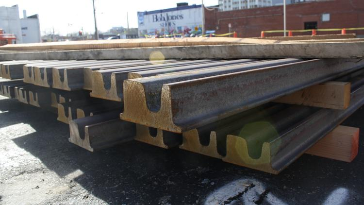 The first shipment of steel rail for the Kansas City's downtown streetcar line awaits construction.