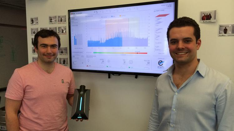 Enertiv cofounders Pavel Khodorkovskiy (left) and Connell McGill Jr., displaying their web-connected building energy use monitor.