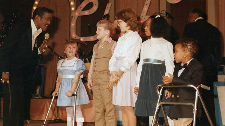 This photo is from around 1984-86 of Sammy Davis Jr. and some Variety kids during a Variety Club telethon.
