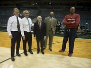 From left, Wesley Edens and Marc Lasry, Herb Kohl, and coaches Jim Cleamons and Scott Williams
