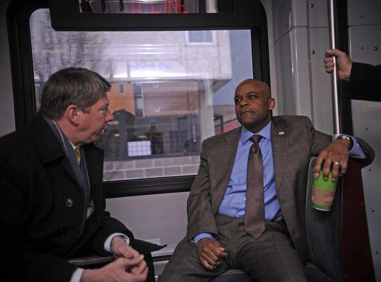 Paul Ryan (left) with Denver Mayor Michael Hancock are seen on a test ride of the soon-to-open West Line of RTD's light rail system.