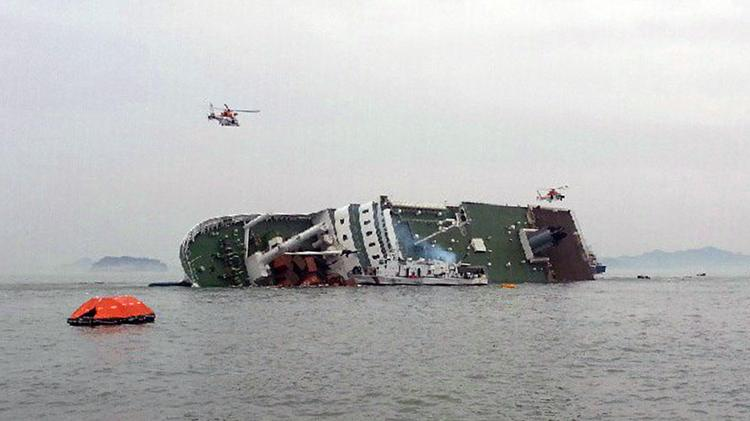 Rescue is underway for passengers on Sewol, a 6,825-ton passenger ship owned by Chonghaejin Marine Co., 20 kilometers off Byeongpoong island, northwest of Jeju, South Korea, on Wednesday, April 16, 2014. The ship, carrying 476 passengers, usually travels between Incheon and the South Korean island of Jeju. Source: Yonhap News via Bloomberg