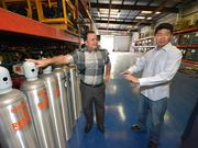 Veterans Pablo Marquez and Matthew Day work in the warehouse at Resolve Marine Group.