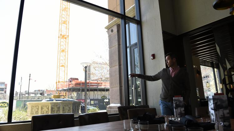 Ben Barnett, general manager at Earls in Cherry Creek, talks about construction in the area while looking out the private dining room window earlier this year.
