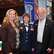 """Maj. Gen. Suzanne M. """"Zan"""" Vautrinot (center) meets with Mark Frye, government program manager for Port San Antonio, and another attendee at the Innotech conference."""