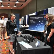 Attendees at the 2013 Innotech conference in the Henry B. Gonzalez Convention Center visit exhibitor booths in the main exhibition area.
