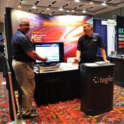 Representatives of Tegile Systems, a Newark, Calif.-based company that sells data storage systems, show off their wares at the 2013 Innotech conference.
