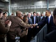 President Barack Obama greets workers after delivering remarks on the National Clean Fleets Partnership at the UPS facility in Landover on April 1, 2011. 