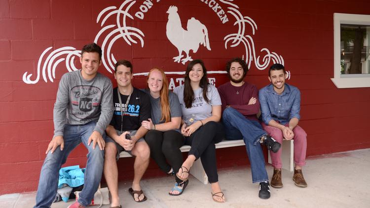 The same group who camped out for the 4 Rivers east Orlando opening just two weeks ago were on hand at 8 a.m. for opening day at The Coop. From left: Nick Gort, Jordan Wellman, Nicole Jones, Liz Wipple, Cameron Henson and Alex Karimipour know good things come to those who sit by a giant painted chicken.