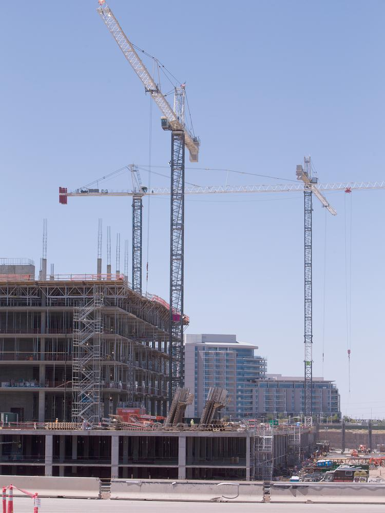 Construction cranes are beginning to dot the Valley's skyline again, cuing the region's growing economic recovery. These are in Tempe helping to build Marina Heights, the state's largest office project under development.