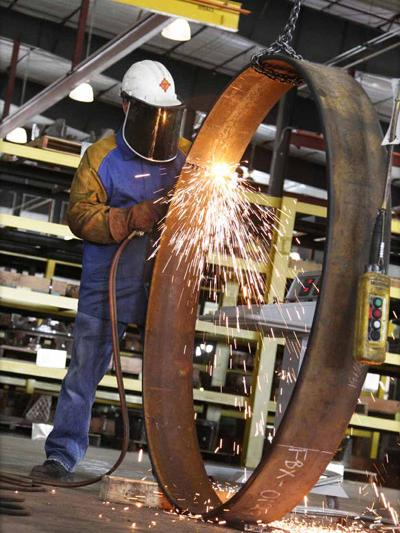 Asked what challenges the manufacturing sector faces in New Mexico, a CEMCO official said that politics presents challenges. A CEMCO worker is pictured.