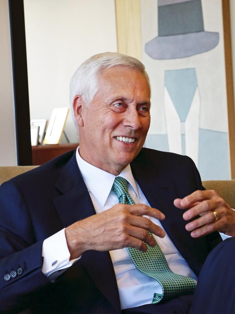 Umpqua Bank reported earnings Monday, one business day after it closed the biggest acquisition in Oregon banking history. CEO Ray Davis (pictured) will discuss the earnings in a conference call Tuesday.