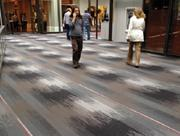 The new owners of IDS Center, Beacon Investment Properties, recently installed new carpeting in the skyway level.