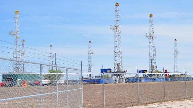 Rigs in operation in the Eagle Ford Shale. Abraxas has sold some of its non-core assets to pump resources back into the Eagle Ford.