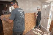 About 20 volunteers from The JBG Cos. spent two days the week of April 18 working to rebuild a house near the Wheaton Metro station that is planned for a single mother in need of an affordable home.