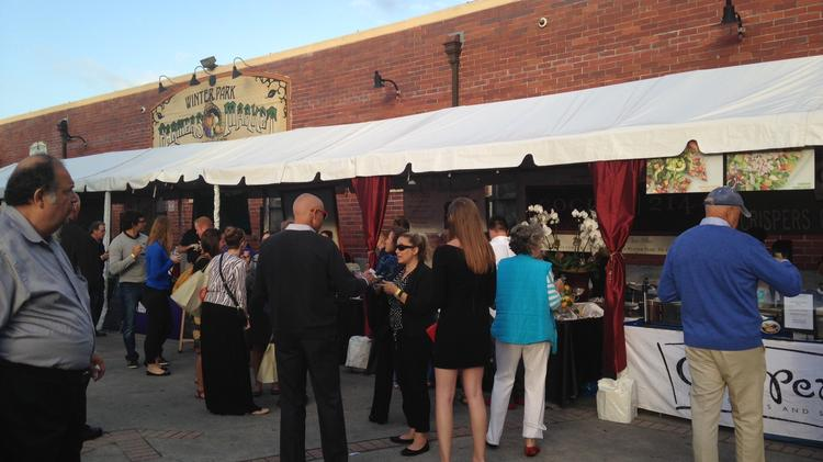 Guests make their way through each of the 40 restaurant booths at the Taste of Winter Park event.