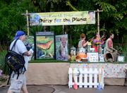 """Meanwhile, back toward the front of the park, special """"Party for the Planet"""" stations featured eco-friendly information and activities as part of the celebration."""