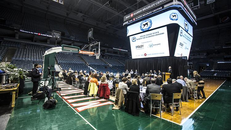 About 100 community and business leaders attended the event at the BMO Harris Bradley Center.