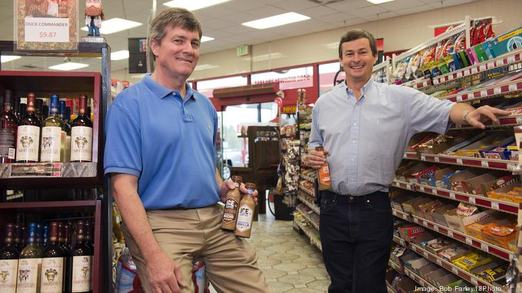 Alan Kidd, right, of Cowboy's convenience store was the first local store owner to sell John Wright's Ice Coffee.