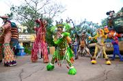 """Animal Kingdom performers and character puppeteers march out to a rendition of """"Circle of Life."""""""