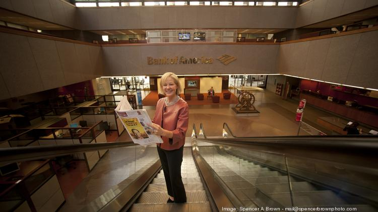 Janet Lamkin, Bank of America's California state president, reads a copy of the redesigned San Francisco Business Times in the bank's San Francisco offices.