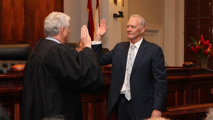 Hawaii Supreme Court Chief Justice Mark Recktenwald, left, administers the oath of office to Michael Wilson, who was appointed to a 10-year term as an associate justice on the state's high court.