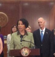 Orange County Superintendent Barbara Jenkins with Gov. Rick Scott at the signing of a sweeping education bill, SB 1076.