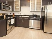 Kitchens at the CityCenterDC apartments will look similar to this one at another DC-area BridgeStreet apartment. The homes are stocked with useful items such as a pizza cutter, wine opener and more to accommodate a long-term stay.