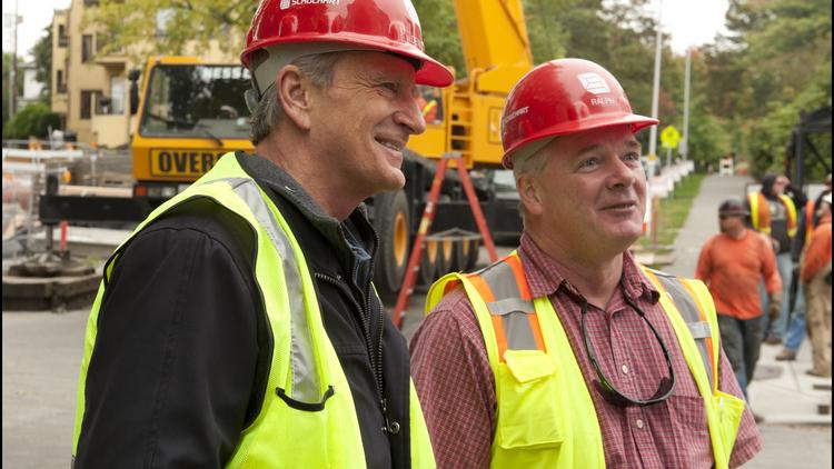 Bullitt Foundation President and CEO Denis Hayes, left, is pictured at the Bullitt Center during construction. Also shown is Ralph Hendrix, who was project superintendent for the general contractor, Schuchart.