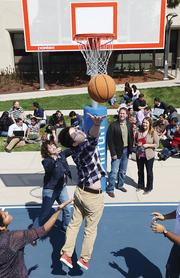 Intuit employees playing basketball.