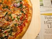 """The pizzas come in 14"""" and 18"""" round varieties and a """"nonna"""" size, an 18"""" rectangle."""
