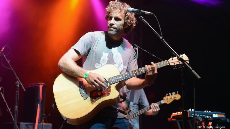 Musician Jack Johnson performs with ALO onstage during the 2013 Bonnaroo Music & Arts Festival in Manchester, Tenn.