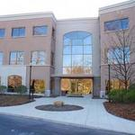 Local investors snatch up office building at auction
