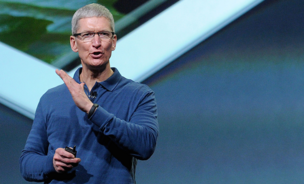 Tim Cook, chief executive officer of Apple Inc., wears what looks like a Nike FuelBand as he discusses the iPad Mini during an event in San Jose, California, on Tuesday, October 23, 2012.