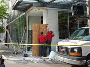 A crew from Glass Doctor works on boarding up the corner of the City Target store at the corner of Second Avenue and Union Street after an overnight hit-and-run that witnesses said involved a white pickup.